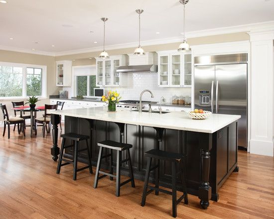 white kitchen cabinets black island black stools subway