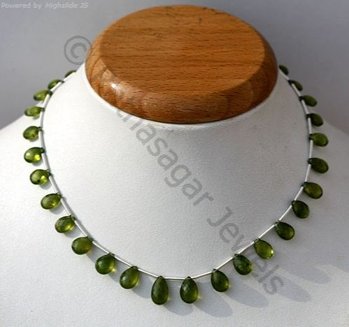 Vesuvianite Beads is a slightly green, brown yellow or a blue silicate mineral that occurs as tetragonal crystals in skarn deposits and in the limestones that have been subjected to contact metamorphism. The uniqueness of this stone has been preserved and enhanced wonderfully by Ratna Sagar Jewels- the wholesalers, manufacturers and retailers of AAA quality Vesuvianite gemstone beads in a variety of shapes, See @ https://www.ratnasagarjewels.com/wholesale-vesuvianite-gemstone-beads.html…