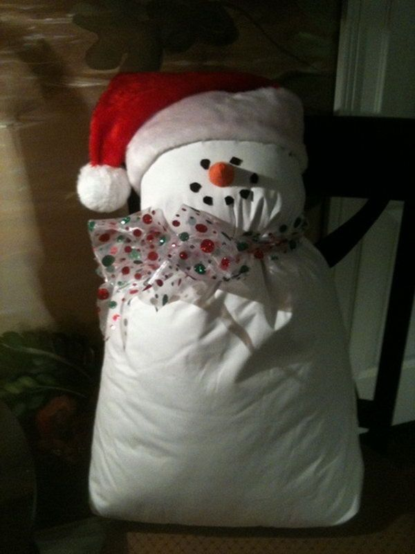 snowman from bed pillow and a santa hat, Cool Snowman Crafts for Christmas, http://hative.com/cool-snowman-crafts-for-christmas/,