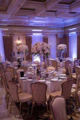Lots of food on wedding table Armenian reception white rose blush flower centerpiece on candelabra