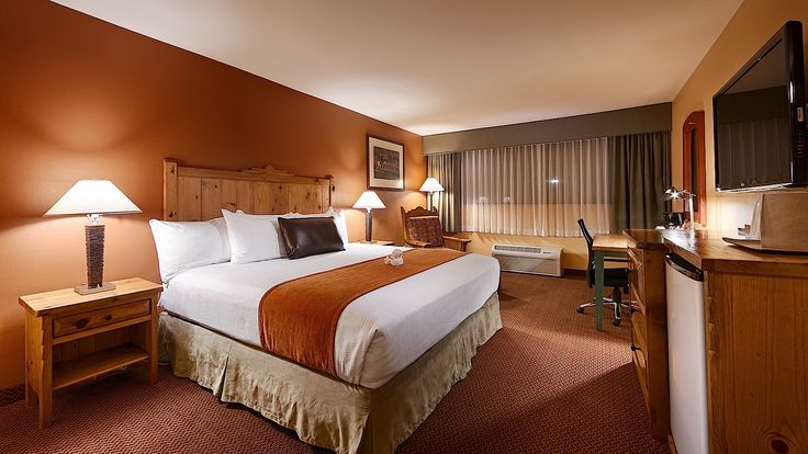 Book your Business King Room today!  Our Business King Room offers 1 King Bed, High Speed Internet Access, Refrigerator, Coffee Maker, Iron, Sitting Area, Handcrafted Southwestern style furniture and décor etc.  http://www.riograndeinn.com/rooms-en.html  #RioGrandeInn #Albuquerque #hotelbooking