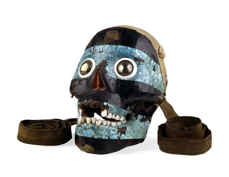 The turquoise mask of Tezcatlipoca is not entirely made of stone. It is actually a real human skull lined with a turquoise and lignite mosaic, with some red oyster shell lining the nasal cavity. The eyes are made from polished pyrite and surrounded by white conch shell. Each of the stones is held in place with a pine resin adhesive.