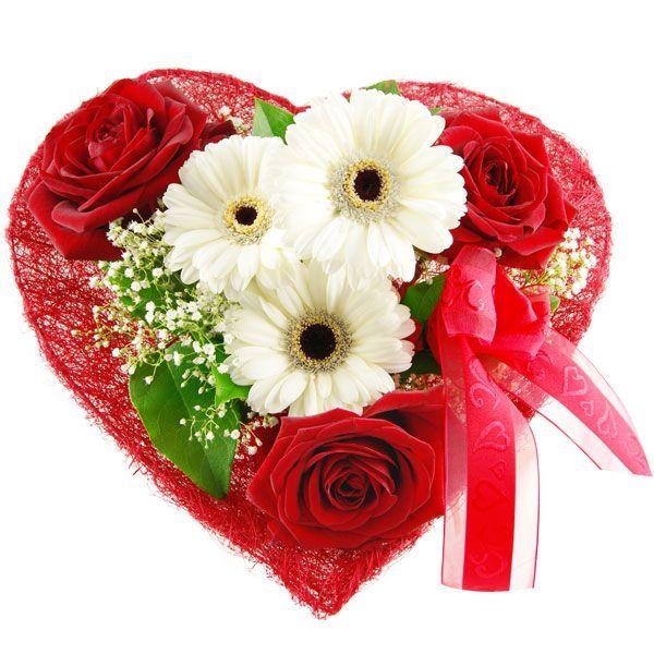 Der Blumenstrauß Blumenherz als ideales Valentinstagsgeschenk. Rosen und Gerberas in Herzform arrangiert. Ein romantisches Geschenk zum Valentinstag, Hochzeitstag oder einfach für zwischendurch.