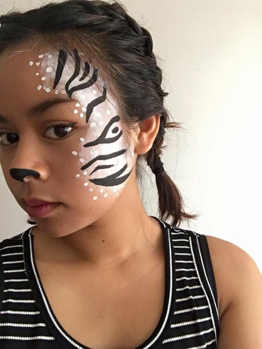 Zebra face paint... Simple... Half face.