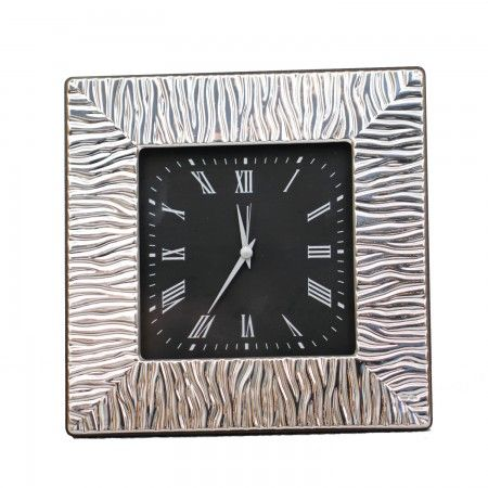 Luxurious clock with an etched sterling silver frame for a stylish desk accessory.