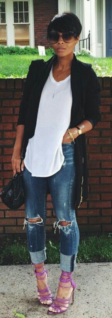 Long jacket, white tee, ripped jeans, strappy sandals.