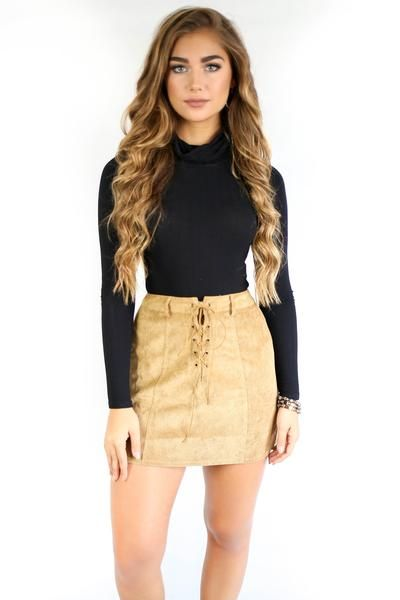 Camel skirt features a lace up detail Corduroy skirt is an A-line Material is Polyester and Nylon Zipper Back No lining Model Addi is 5'6 and is wearing a small