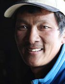 Phurba Tashi Sherpa--he is the person with most total ascents to eight-thousand meter peaks, with 28. These include 19 ascents on Mt. Everest, 5 on Cho Oyo, 2 over Manasulu, and one each over Shishapangma and Lhotse.  He is the lead expedition Sherpa for the Himalayan Experience guides under expedition leader Russell Brice.