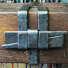 Iron band and mechanical connection.  Wonderful honest view of how band is held together on timber mantel. AntiqueWoodWorks.com