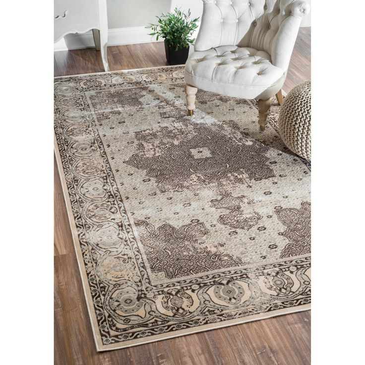 This vintage-style viscose rug brings a classic look to your contemporary living space. The ultra-soft faux silk surface feels great on bare feet, and the unique design is sure to garner plenty of compliments from friends and family alike.