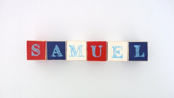 Personalised Wooden Blocks make the perfect addition to any nursery. Place the baby blocks on a bookshelf, dresser or use them as a wooden toy. Wooden baby blocks also make a wonderful personalised new baby gift that can double as a photo prop. Wooden name sign blocks can be custom coloured to match you nursery decor.  Small blocks are 4.2 cm square (made of pine), hand painted with water based paint and stamped with your childs name. To add to their unique look, wooden blocks have been…