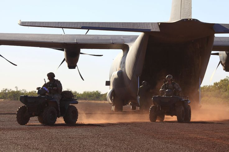 Combat Controllers from No. 4 Squadron unload All Terrain Vehicles from a C-130J Hercules at the Delamere Range Facility in the Northern Territory during Exercise Pitch Black 2014. CPL David Gibbs Copyright © Commonwealth of Australia, Department of Defence