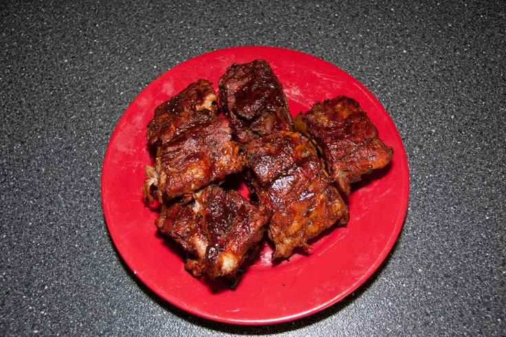 Ribs i just made tonight  rubbed in pork spice, let sit for an hour. put in foil with 1/4 cup water and tightly sealed after brushing with bullseye bbq sauce.  cooked for 3 hrs low heat.. took out and mopped more bbq sauce on for 2o min more cooking time... fall off the bone yum !