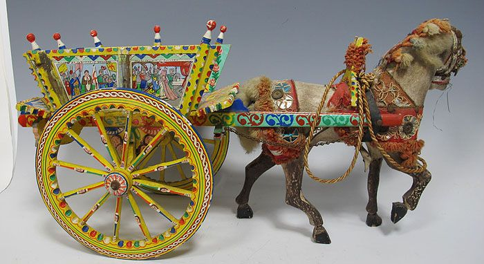 The Sicilian cart (or carretto siciliano in Italian and carrettu sicilianu in Sicilian or carretti (plural)) is an ornate, colorful style of horse or donkey-drawn cart native to the island of Sicily, in Italy.  The carts were introduced to the island by the ancient Greeks. Carts reached the height of their popularity in the 1920s, when many thousand were on the island.