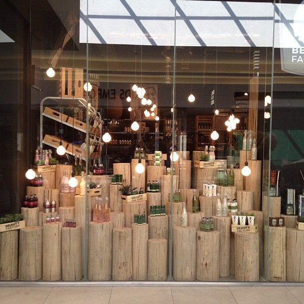 Wood logs for display have them graduating all the way up for Retail shop display ideas
