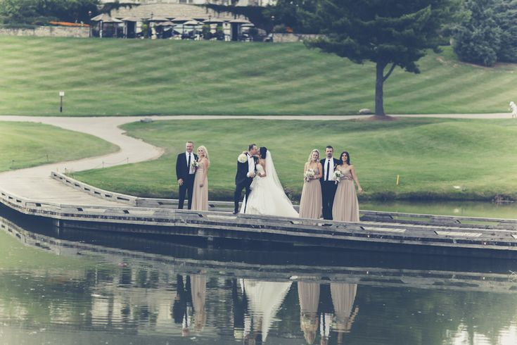 Love this shot with the reflection in the water at King Valley Golf Club - Images captured by PurpleTree Wedding Photography.