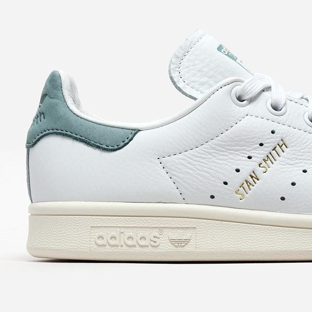 NEW IN! The white and vapour steel Adidas Stan Smith is now available! A fresh, modern update to the Stan Smith, these shoes are made from super soft, premium tumbled leather. A vintage golden Adidas logo nestled between the second and third perforated http://www.95gallery.com/