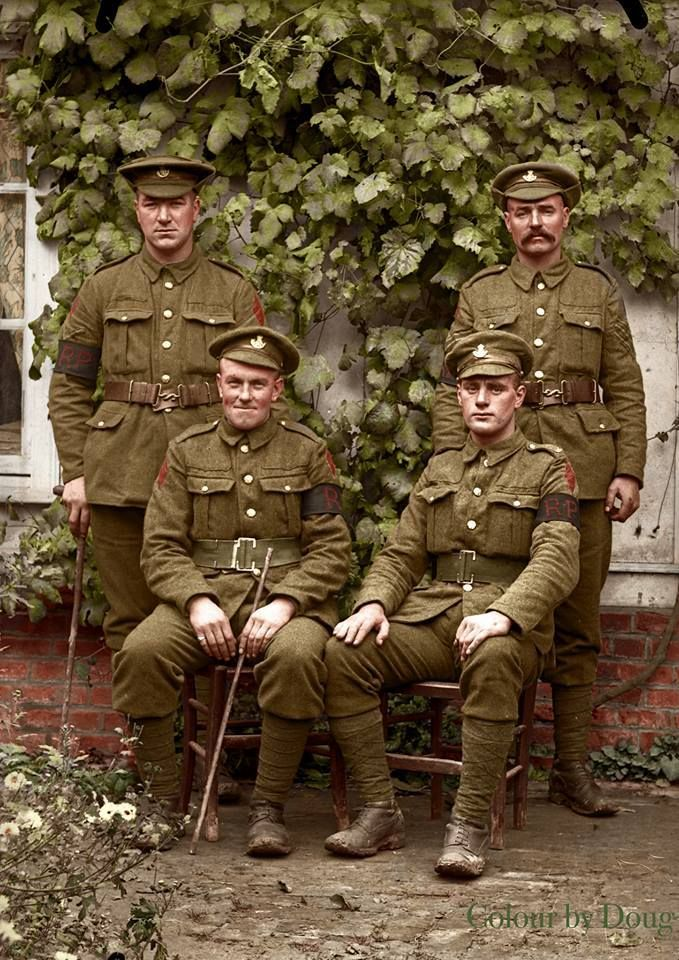 Four Durham Light infantry Regimental Police in a photographers garden in Warloy-Baillon, Somme, Northern France, in 1916 Photo original by courtesy of: Bernard Gardin, Dominique Zanardi and Joel Scribe This photo was taken by an amateur photographer, Alfred Dupire at 45, Rue d'Amiens, Warloy-Baillon, in 1916. It is from a collection of glass plates found about eight years ago.