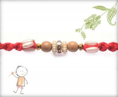 Buy Online Rakhi - #Designer #Sandalwood #Diamond #Rakhi, Exclusive White Pearls Sandwood Diamond Rakhi, surprise your loved ones with roli chawal, chocolates and a greeting card as it is also a part of our package and that too without any extra charges. http://www.bablarakhi.com/