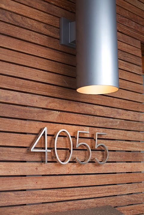 Teak horizontal slatted rainscreen and nice modern house numbers.