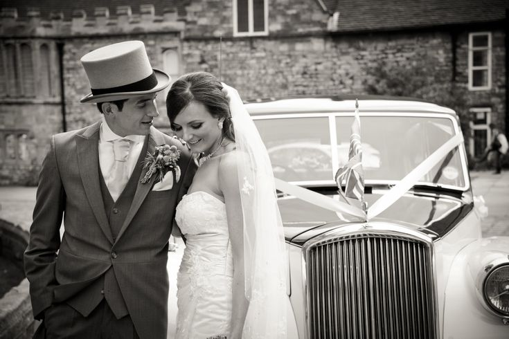 Black and white, timeless, newly wed photograph. Wedding car with bride and groom. Top hat and tails wedding attire. Lincolnshire Cathedral, Lincolnshire bailgate wedding Courtney Louise Photography