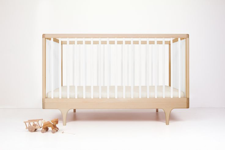 Caravan Crib White - Sustainably made in the U.S.A. Inspired by the storybook circus wagon and made almost entirely by hand, the Caravan Crib plays with classic form and contemporary, ultra-bold colors. #kalon