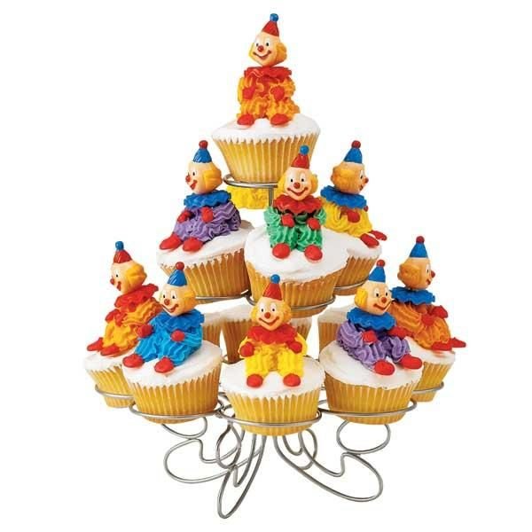 Clown Cupcakes - Any cupcake is more fun with a 3-D clown sitting on top! Use star tips to build up his body in a few easy steps. Top him off with a smiling Derby Clown Topper for a treat that will make anyone´s day!