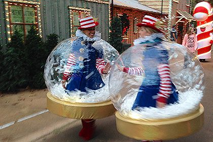 Inflatable Snow Globe Costumes Are A Hit At Rudolph's Holly Jolly™ Christmas Light Parade at Silver Dollar City, Branson, MO