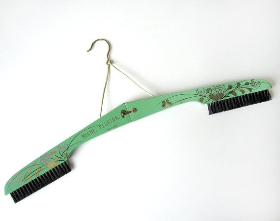 Vintage travel folding clothes hanger and brush souvenir by modernpoetry