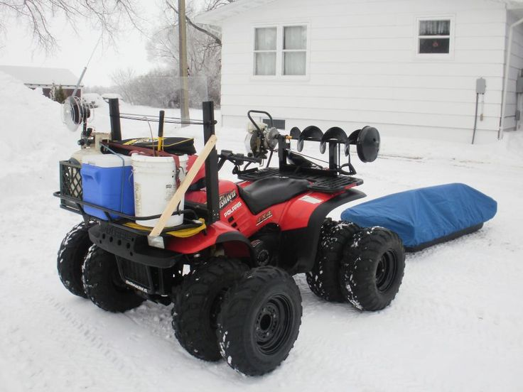 to go ice fishing pulling a nanook clam fish house