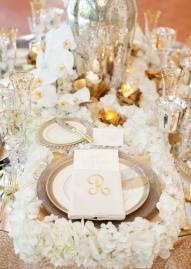 This pretty place setting can be found in the Fall/Winter 2012 issue of Brides of North Texas! Gold, gorgeous and glamorous-oh my! Photo by Perez Photography #wedding #gold #white #place #setting #glamorous