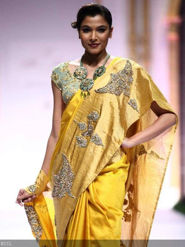 A model showcases a creation by designer Pallavi Jaikishan during India Bridal Fashion Week '13, held at Grand Hyatt, in Mumbai.