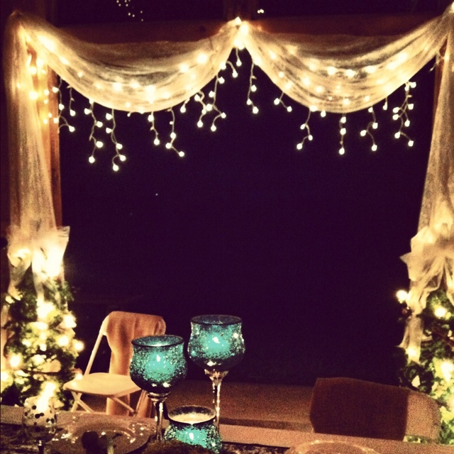 Lace curtains & twinkle icicle lights make the barn so much more romantic.