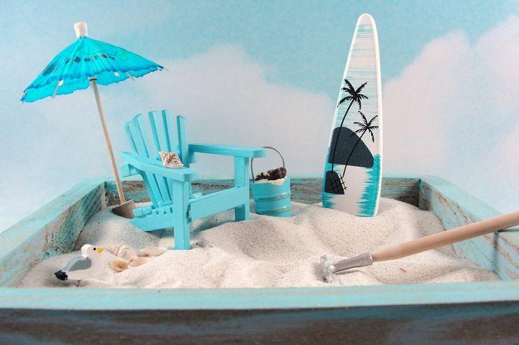 miniature zen beach garden, light blue wash, blue adirondack chair, umbrella, seagull, bucket of shells, surfboard. $27.95, via Etsy.