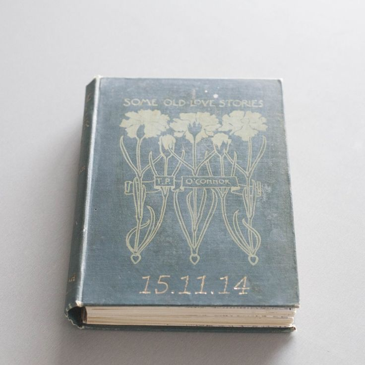 Date embossing on 'Some Old Love stories' Vintage repurposed book for wedding guest book.