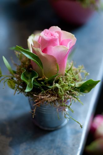 single rose OR annual flower planted in a tiny bucket OR tiny red clay pot...at each place setting (with a larger version as centerpiece)...gotta do this!