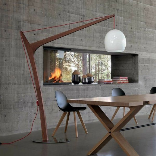 A stylish and modern floor lamp design adds to the atmosphere in every home with its original organic wooden structure and accent colors. The floor lamp is a part of the last collection of the French brand Roche Bobois.