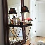 dens/libraries/offices - Benjamin Moore - Brandon Beige - Bar Floor Mirror Chrome Table Lamp Zebra Rug Oak Floor Craftsman Door Transom Vignette Zebra Hide