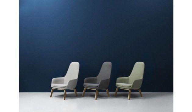 Der Era Sessel mit Holzgestell wurde 2014 vom erfolgreichen dänischen Designer Simon Legald für den skandinavischen Hersteller Normann Copenhagen entworfen. Die minimalistische und organische Form des Sessels in Kombination mit dem schlichten Holzgestell machen den Sessel zum Design-Highlight des skandinavischen Stils. Diese perfekte Symbiose wurde 2015 mit dem German Design Award ausgezeichnet.