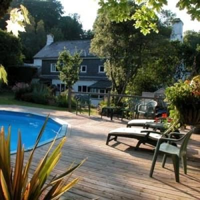 Charming 17th Century cottages in Marldon, with outdoor solar heated swimming pool and sun deck with loungers Ideal for families. www.iknow-devon.co.uk