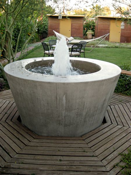 precast concrete fountain - great contrast w/ wood deck