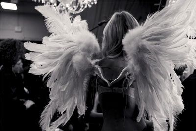 Wings, luxury underwear, and an impossible body. Backstage photo of a Victoria's Secret fashion show by Daniella Rech.