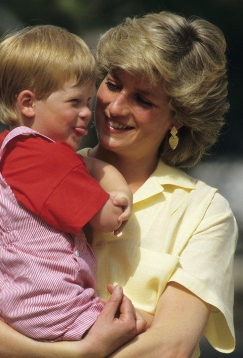 Princess Diana and Prince Harry posing during their holiday in Majorca,Spain