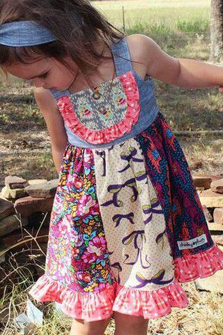 Cheeky Plum Vera Dress ***Runs Small/Short*** Burgundy knit top that buttons down back Colorful skirt that portrays birds, flowers and butterflies 3 Tier Ruffle Skirt