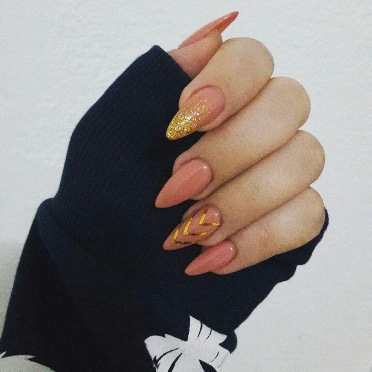 Stiletto nails gold nails