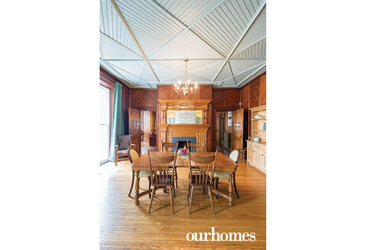 The south side of the large kitchen at Lakehurst retains its historic look with a carved wooden fireplace mantel, hardwood floor and herringbone panelling on the walls and ceiling.   See more of this home in OUR HOMES Peterborough Early Summer 2016 http://www.ourhomes.ca/articles/build/article/180yearold-cobourg-loyalist-home-restored