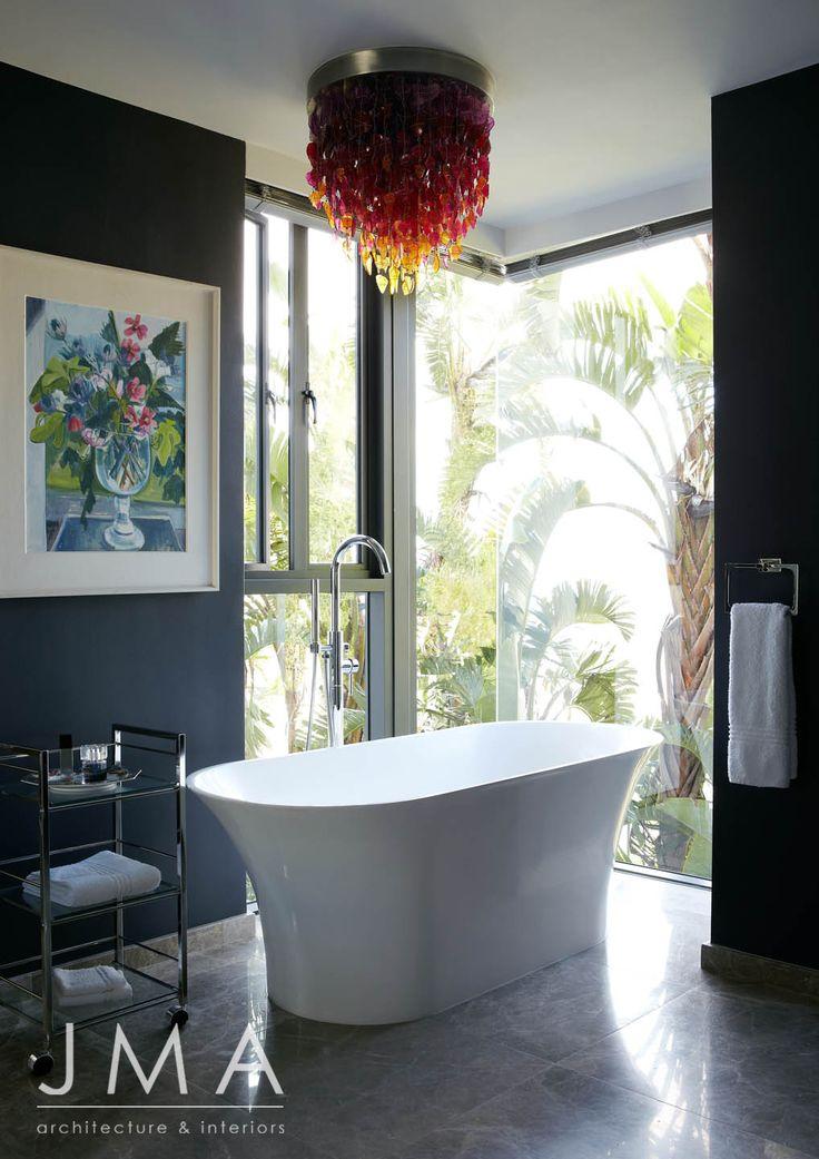 Warm, bright, bathroom chandelier.