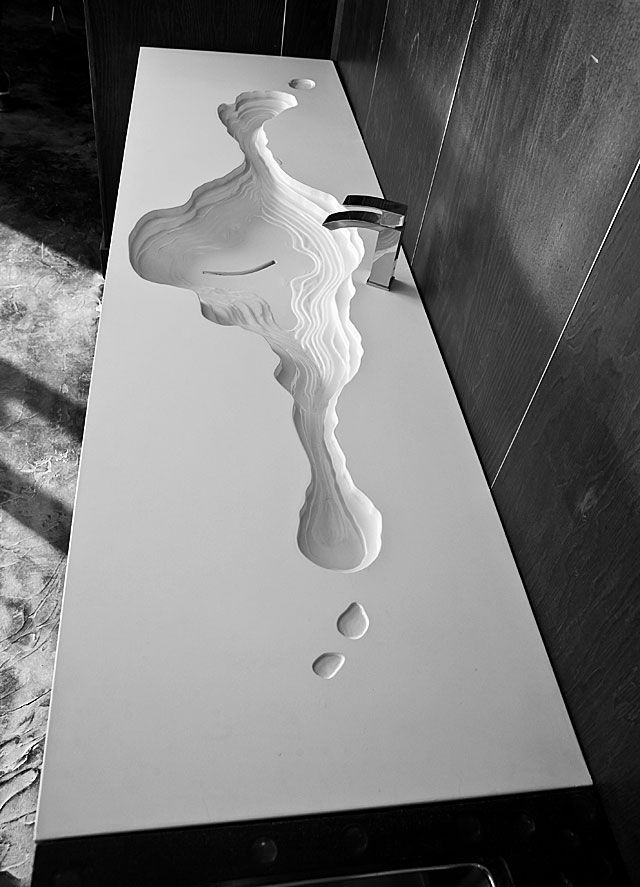 Add organic shapes into your interior with interesting surfaces and fixtures. Great for kitchens and bathrooms.