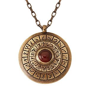 """This solid brass pendant mimics a DHD, with its concentric circles of glyphs and a red carnelian gemstone as the Control Crystal. Antiqued by hand and strung on a 24"""" brass chain, this statement piece doesn't need to come with a Stargate to look amazing."""