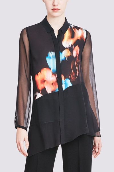 AISLEY BLOUSE IN BLACK FLORAL: An all-season favorite, this double georgette silk blouse is fashioned with asymmetrical sheer and opaque fabric in an original Elie Tahari print. Finished with a techno-jersey collar, the top delivers haute style with ease.